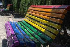 Park bench painted in the colours of the rainbow
