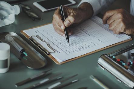 a man completing a checklist