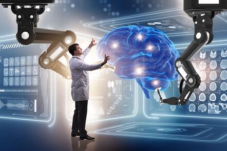 Robot hands touching human brain