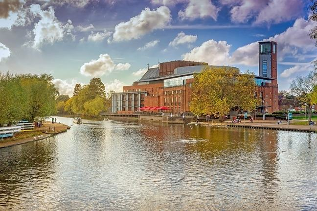 The river Avon with the Royal Shakespeare Company theatre in the background, Stratford upon Avon, UK