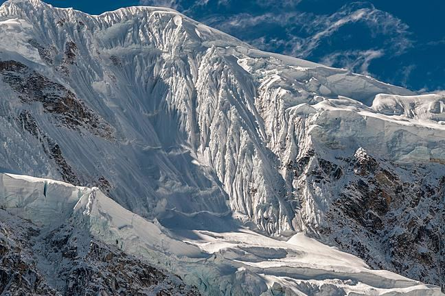 An image of a glacier surrounded by steep mountains.