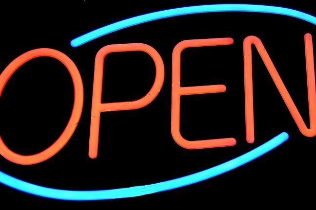 A illuminated neon 'Open' sign