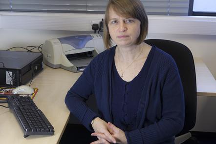 Lecturer at desk