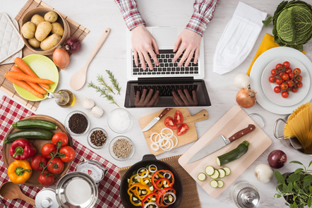 Cooking at home with online recipes.