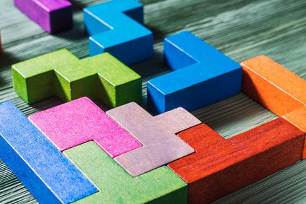 Coloured wooden building blocks on a table