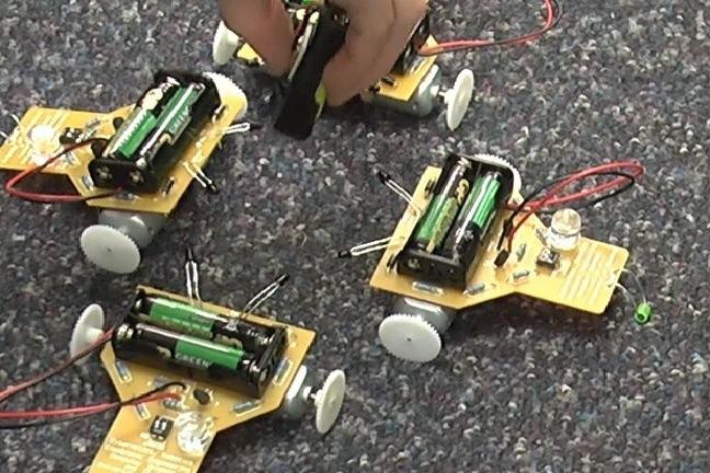 Four small light-seeking robots