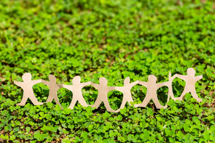 Human chain paper on green creeper plant, CSR (corporate social responsibility) concept.