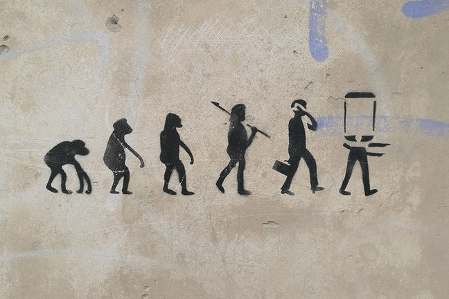 Stenciled evolution of man from ape past to mobile-headed.