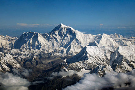 Mount Everest as seen from an aircraft showing jagged and huge, snowy mountain ranges