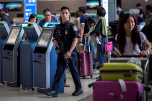 Policeman walking through airport