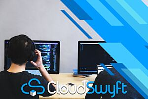 A man sitting with headphones in front of a computer. The image is labeled Cloudswyft.