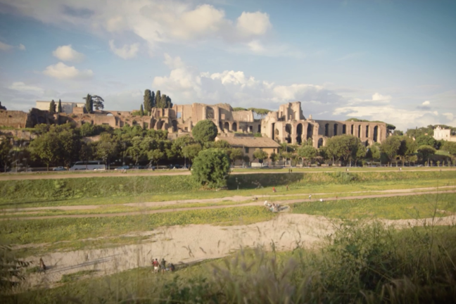 The Circus Maximus in Rome today. A large field with patches of grass.