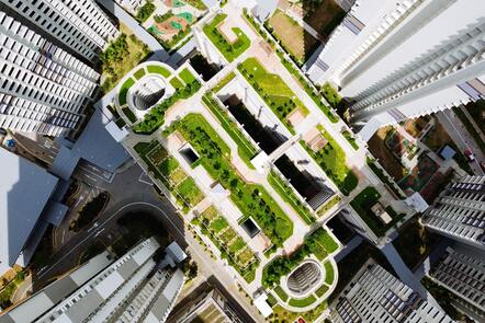 An aerial view of condominiums and their shared green space.
