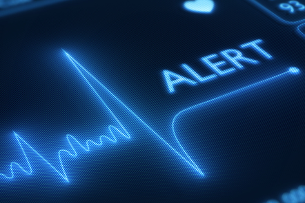 A screen showing a heart tracing with the word 'Alert' at the side.
