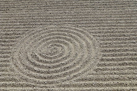 Sand raked into a spiral pattern