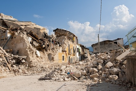 Damaged and destroyed buildings and rubble following an earthquake