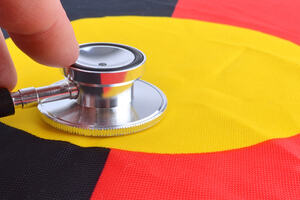 the indigenous flag with a stethoscope laid against it