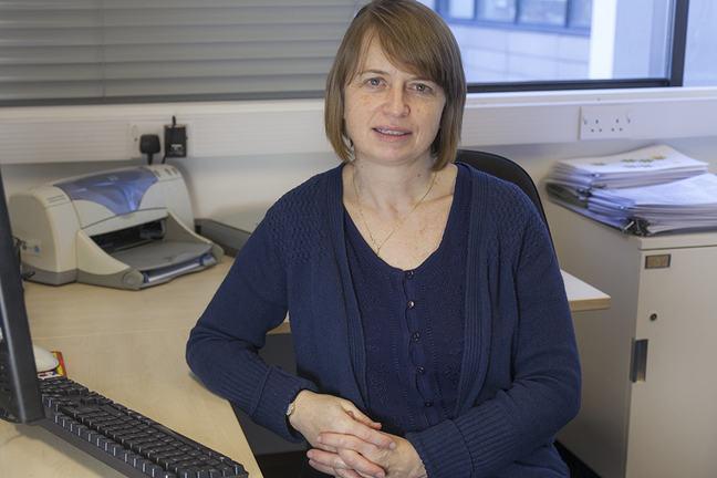Lecturer at a desk