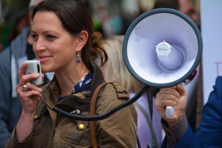 woman speaking into megaphone