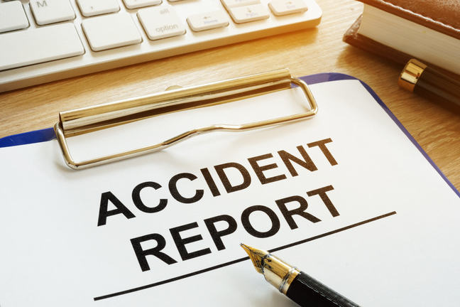 Illustration clip board with pen and the words accident report
