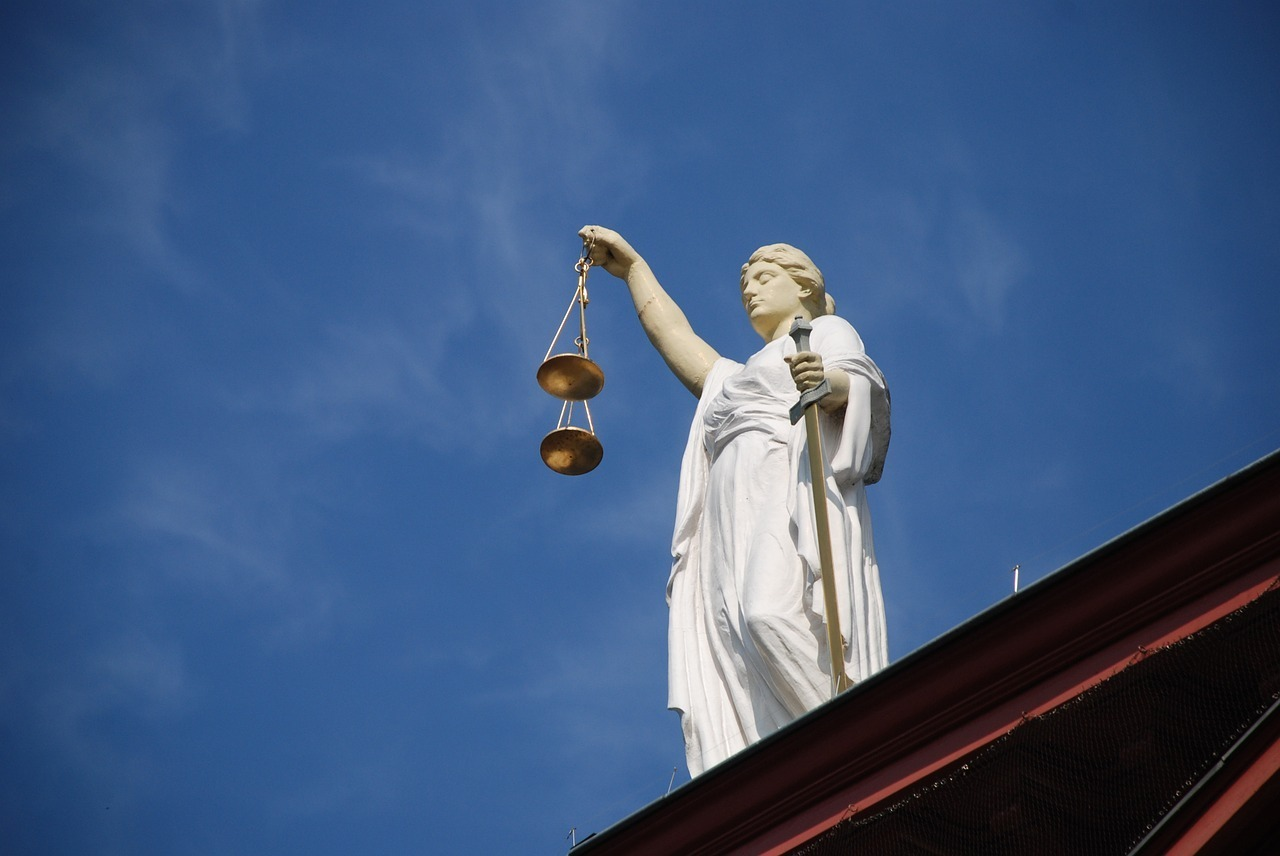 Statue of Justice carrying scales