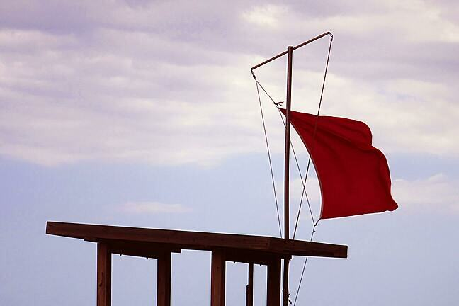 Red flag waves in the wind