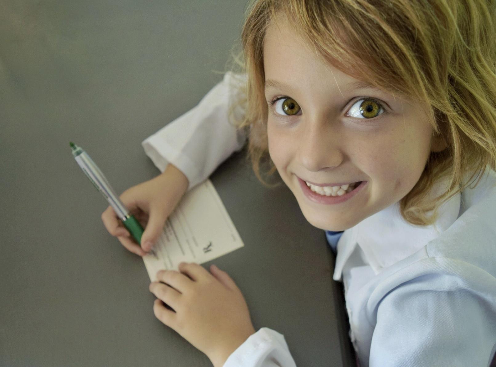 Girl writing and imagining