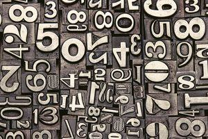 Maths Puzzles: a photograph of old metal numbers