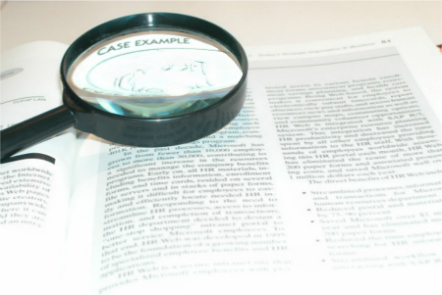 image of magnifying glass on paper