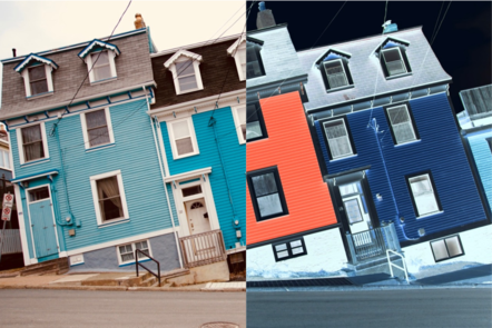 A set of houses that are built to slant to the left. The right-hand side of the image has been converted to a negative.