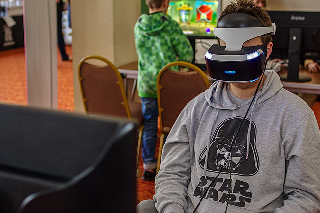 Boy wearing VR headset wearing Star Wars jumper