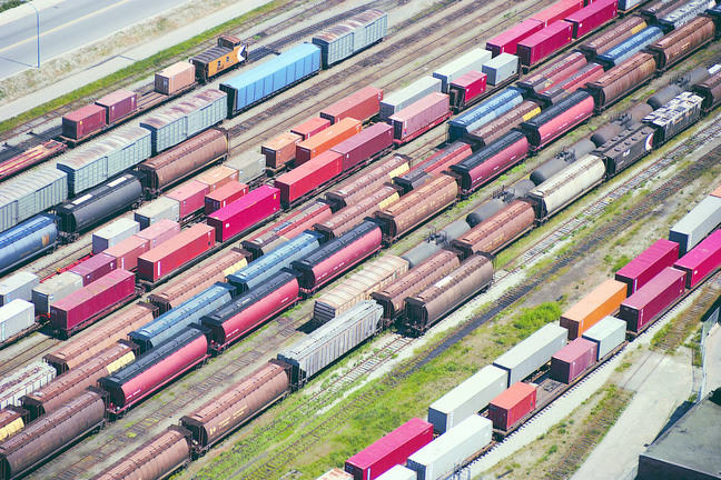 View from above down onto rows of containers on railway tracks sidings