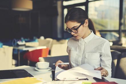 A woman revising notes.