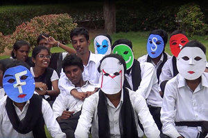 A group of young people in India wearing face masks with social media logos on.