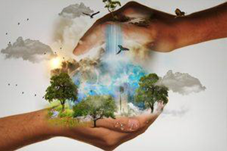 Hands around world of trees and pollution