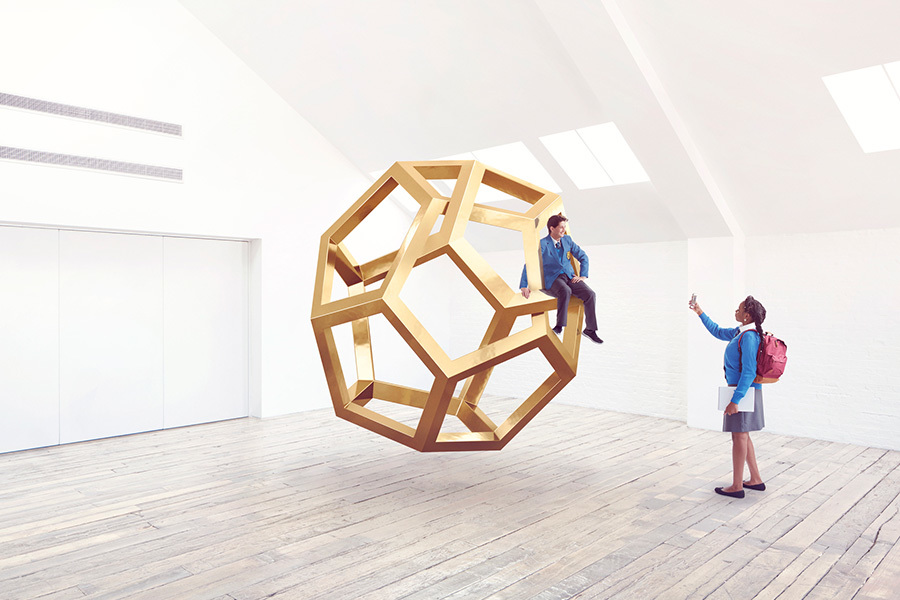 School kids interacting with an Impossible shape.