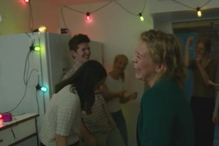 Young people dancing at a party.