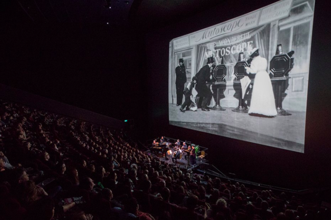 Image of people in the cinema watching archive black and white film