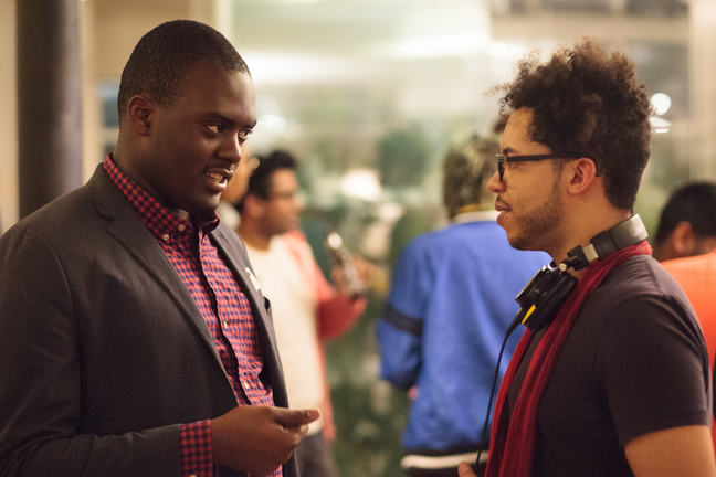 Two developers chat at a networking event