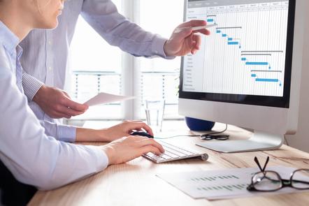 Project management team analysing deadlines with a Gantt chart