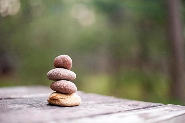 A photograph of three stones balanced on top of one another