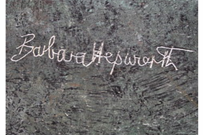 A photograph showing a close up, cropped shot of Hepworth's signature carved into a bronze statue.