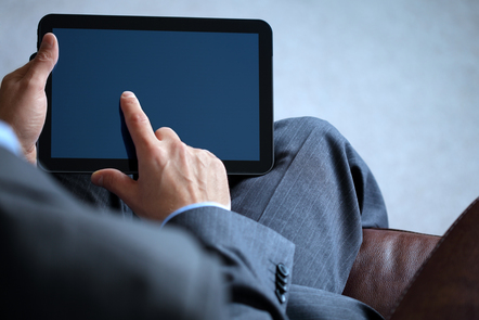 Man looking at tablet device