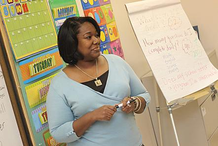 a photo of a black woman teaching