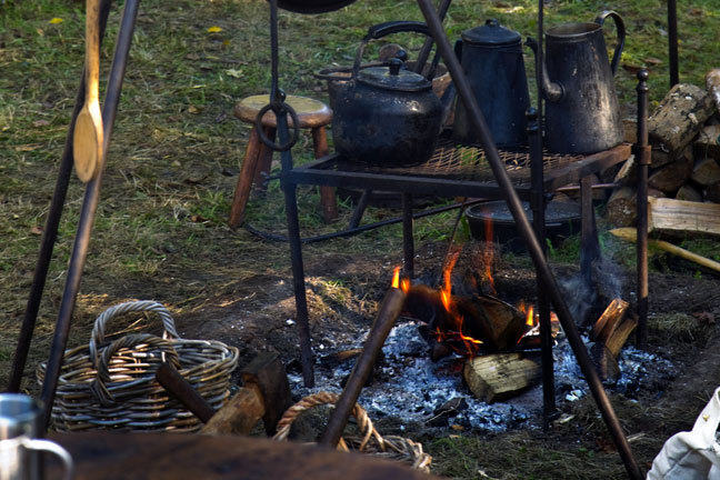 campfire with iron cookery equipment