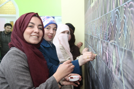 Women drawing on a blackboard