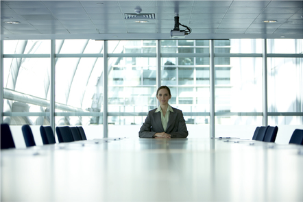 woman sitting alone in a meeting room