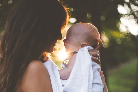 Photo of woman with her baby