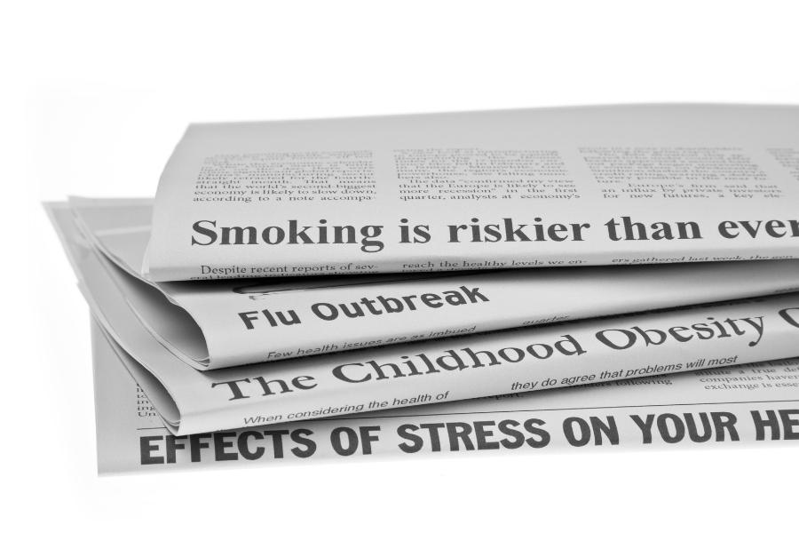 Series of newspaper headlines reporting health stories