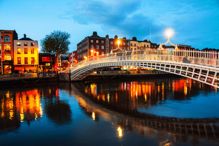 Dublin at sunset - view of the Ha'penny bridge and shops.